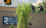 BG_0277 S.W.A.T. team members search the roof of the  during a robbery at Bellco Credit Union at...