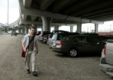 Brad Bettag (cq) heads to his parked car, Tuesday afternoon, July 22, 2008,  at the Park-n-Ride...