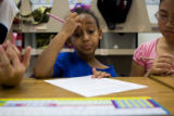 Elsa Negasy, 9, (cq) a fourth grader attending Village East Community Elementary School at 1433...