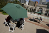 43  Diners duck under the shade of umbrellas and enjoy lunch with live music playing in the...