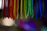 A rainbow string wind sock hangs from the ceiling at Herbs & Arts on July 31, 2008 in Denver,...
