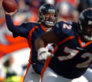 (Denver, Colorado, Dec. 12, 2004) Jale Plummer passes against the Miami Dolphins in the 1st...