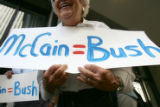 Joanne Salzman, holds an anti-McCain sign outside the Grand Hyatt in Denver, Colo., on Friday,...