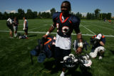 Eddie Royal 19,(cq) walks off the field after The Denver Broncos work out Sunday morning, July 27,...