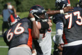 Nic Clemons, (cq) defensive tackle fights to get past Tom Nalen, (cq) center, during the Denver...