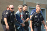 Knoxville Police Department officers lead an unidentified man to a squad car Sunday 072708,...
