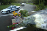 A make-shift memorial of flowers and cards lay on the front sign of the Tennessee Valley Unitarian...