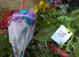 Sunday, July 27, 2008  A make-shift memorial of flowers and cards lay near the front sign of the...