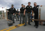 1152  Summit County Sheriif John Minor and other local law enforcement officers push open the east...