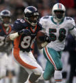 (December 12, 2004) -- Denver Broncos receiver Rod Smith, #80, picks up nine yards on a pass past...