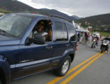 1729  Motorists honk their horns and wave after the Dillon Dam Road/ Summit County Road 7 reopened...