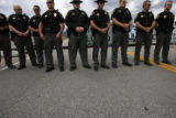 1734  More than two dozen Summit County law enforcement officers stand at the east gate of the...