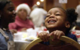 DENVER, Colo, December 12, 2004) Taija Hollowell,4, from Denver can barely hold in her joy as she...