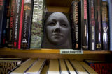 Book ends and creatures decorate the shelves at Capitol Hill Books on July 31, 2008 in Denver,...
