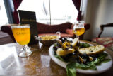 Mariniere Mussels in a white wine sauce for $11 and seasoned fries with Carolus and Tripel...