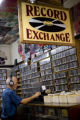 Paul Condit of Lakewood, Colo. previews records at Jerry's Record Exchange on July 31, 2008 in...