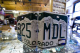 Expired Colorado license plates are used to make photo and CD holder cases by Little Earth for...