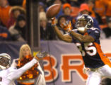 [(Denver, CO, Shot on: 12/12/04)]  Denver Broncos Ashley Lelie(right) can't pull Jake Plumers pass...