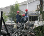 Early Monday morning August, 4, 2008 fire investigators from West Metro work to determine the...