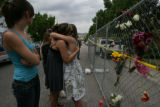 Danielle Jacoby, 19 (cq) and Nicole Campos, 19 (cq) hug in front of the house where Jeremy...