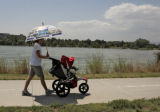 Stephanie Schroeder (cq) takes her nephew, Colin Taylor for a walk around Sloan's Lake, Tuesday...
