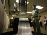 Jim Williams (cq), an Operations Manager for the Denver Elections Divison tests one of dozens of...