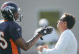 BG_0201 Denver Broncos #15 Brandon Marshall and wide recievers coach Jedd Fisch chat during...