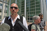 Glenn Spagnuolo (cq) of Recreate 68  stands in front of the Federal Courthouse in Denver during a...