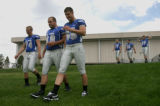 Football players , left to right front row, Chase Darden, Anthony Barr and Alexander Arndt head to...