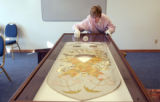 (Denver, Colo., December 20, 2004) Joan Loughridge, owner of Dry Creek Gold Leaf, checks for...