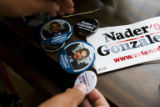 Junue Millan, (cq) volunteer coordinator of the Ralph Nader campaign organizes buttons. Nader...