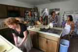 (from left to right) Margie Phillips (cq) and her husband Jim Phillips (cq) make breakfast at...