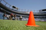 Members of the media take a tour of Invesco Field on Thursday, July 31, 2008. Orange cones on the...