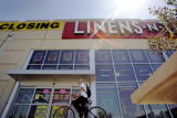 Signs hang in the widows of Linens 'n Things during a closing sale at the Lakewood store on...