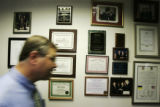 Bob Schaffer walks by plaques at his campaign headquarters in Greenwood Village on Thursday, July...