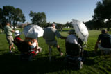 BG_0640 Fans hide from the morning sun on the fiirst hole as the 2008 U.S. Senior Open at the...
