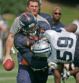 (seqn) Denver Broncos #78 Ryan Clady man handles Dallas Cowboys #59 Terrius George as the two...