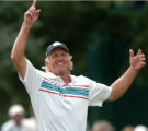 FRIDAY AUGUST 1ST, 2008  Greg Norman gestures to the sky after he made a drive while a gust of...