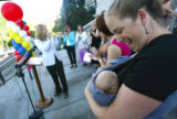 Heather Thompson (cq) smiles at her son Jaden King (cq), 3 months, at a rally for HB 1276, a bill...