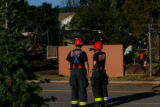 3670  Investigators with West Metro Fire and Rescue survey the scene of a fire in the Roxborough...