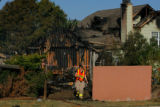 3689  Investigators with West Metro Fire and Rescue survey the scene of a fire in the Roxborough...