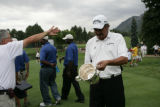 Eduardo Romero (cq) admires his trophy after winning the U.S. Senior Open Championship at The...