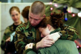 (COLORADO SPRINGS, Colo., Jan. 4, 2005) Staff Sgt. Charles O'Neil hugs his stepdaughter Nichole...