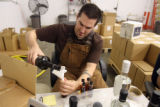 Erich Harbowy (cq) pours sample spirits  for Leopold Brothers in Denver Thursday September...