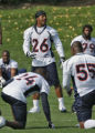Denver Bronco rookie cornerback, Jack Williams, goes through stretching exercises before practice,...