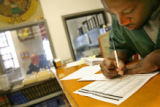 MJM084 Denver County Jail inmate, Akinyele Chatmon (cq) fills out an absentee ballot Friday...