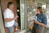 BG_0122 Holly Hansen, right, has a laugh with independent voter Rob Burns as she canvases a...