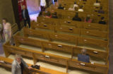 (096)  Ken Johnson, bottom right, of Phantom Pew website, sits in an empty pew as members of the...