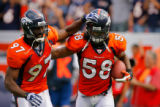 DM1128  Denver Broncos linebacker Nate Webster #58 celebrates with linebacker Boss Bailey #97...