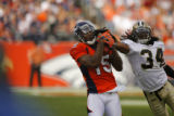 DM1562  Denver Broncos wide receiver Brandon Marshall #15 pulls in a 34-yard pass from quarterback...